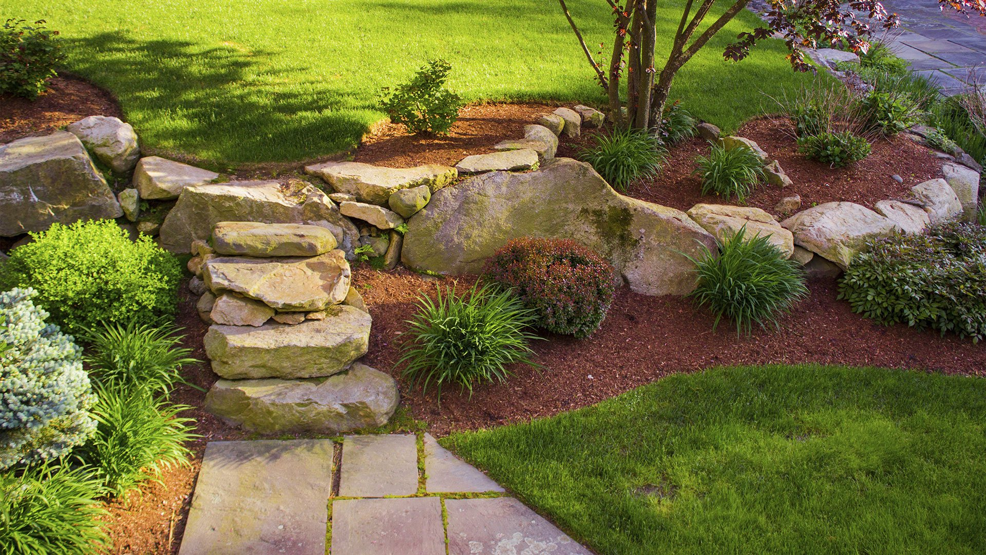 Home lakewood landscape supply boulders and rip rap for Small red rocks for landscaping